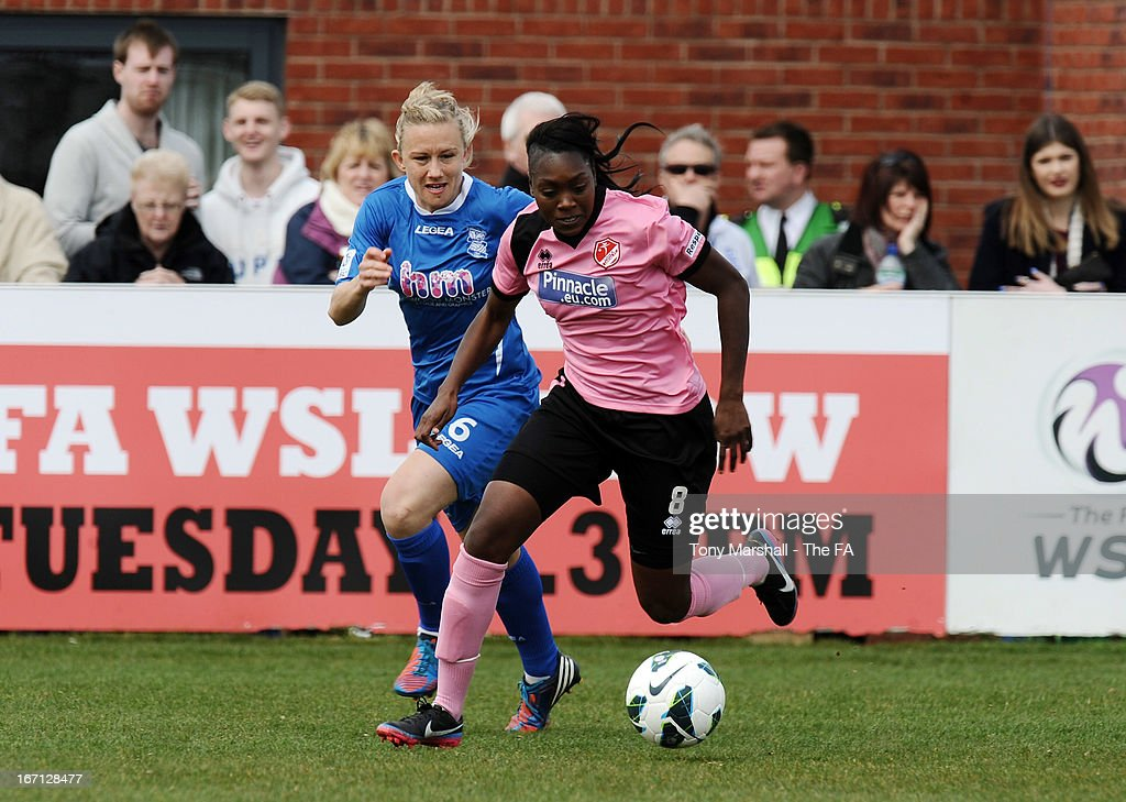 Precious Hamilton of Lincoln Ladies (R) comes under pressure from <a gi-track='captionPersonalityLinkClicked' href=/galleries/search?phrase=Laura+Bassett&family=editorial&specificpeople=5984733 ng-click='$event.stopPropagation()'>Laura Bassett</a> of Birmingham City during the FA Women's Super League match between Birmingham City Ladies FC and Lincoln Ladies FC at DCS Stadium, Stratford Town FC on April 21, 2013 in Stratford, England.