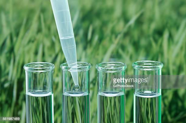Precision micropipette transferring liquid into test tube