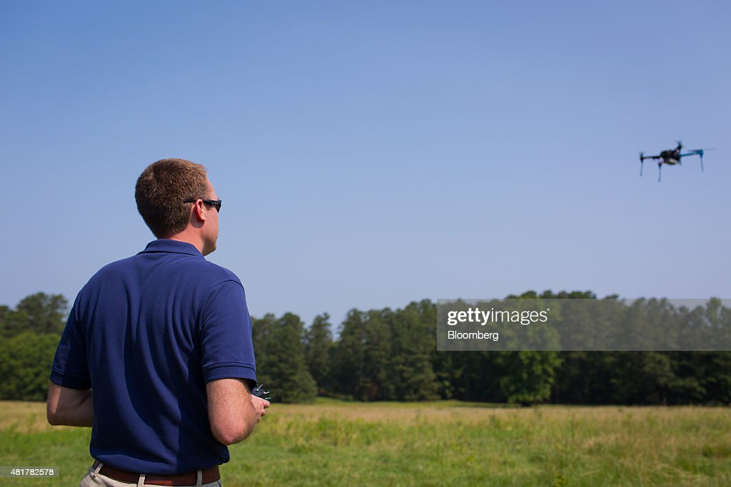 A PrecisionHawk employee demonstrates a drone featuring LATAS (Low Altitude Tracking and Avoidance System) in Durham, North Carolina, U.S., on Tuesday, July 7, 2015. Google Inc. is joining some of the biggest companies in technology, communications and aviation -- including Amazon.com Inc., Verizon Communications Inc. and Harris Corp. -- in trying to create an air-traffic control system to prevent mid-air collisions. PrecisionHawk, a Raleigh, North Carolina, drone company with about 100 employees, began developing its own drone traffic control system because the large agriculture and oil companies it flies for wanted something to keep tabs on unmanned flights. Photographer: Jason Arthurs/Bloomberg via Getty Images