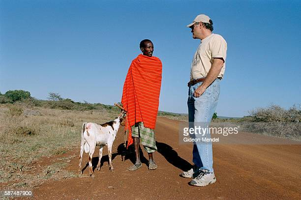 Predator biologist Laurence Frank talks to a Masai cattle herder on Mugie Ranch in the Laikipia District He is the head of the Laikipia Predator...