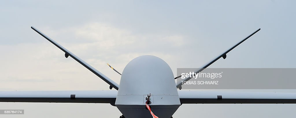 A 'Predator MQ-9' drone is on display at the International Aerospace Exhibition (ILA) in Schoenefeld on May 30, 2016. The Aerospace Exhibition at Schoenefeld Airport near Berlin takes place from June 1 till 4. / AFP / TOBIAS