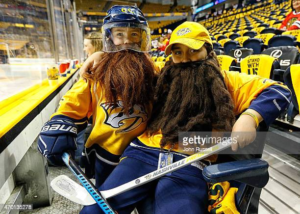 Predators fans Maddox Cross left and Riley Staton sport their playoff beards as they wait near the glass for warmups between the Nashville Predators...