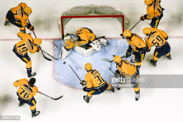 Predators teammates attempt to score on Nashville Predators goalie Pekka Rinne during warmups prior to game 6 of the 2017 NHL Stanley Cup Finals...