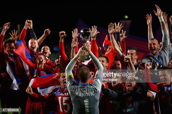 Predrag Rajkovic of Serbia holds up the trophy following the FIFA U20 World Cup Final match between Brazil and Serbia at North Harbour Stadium on...