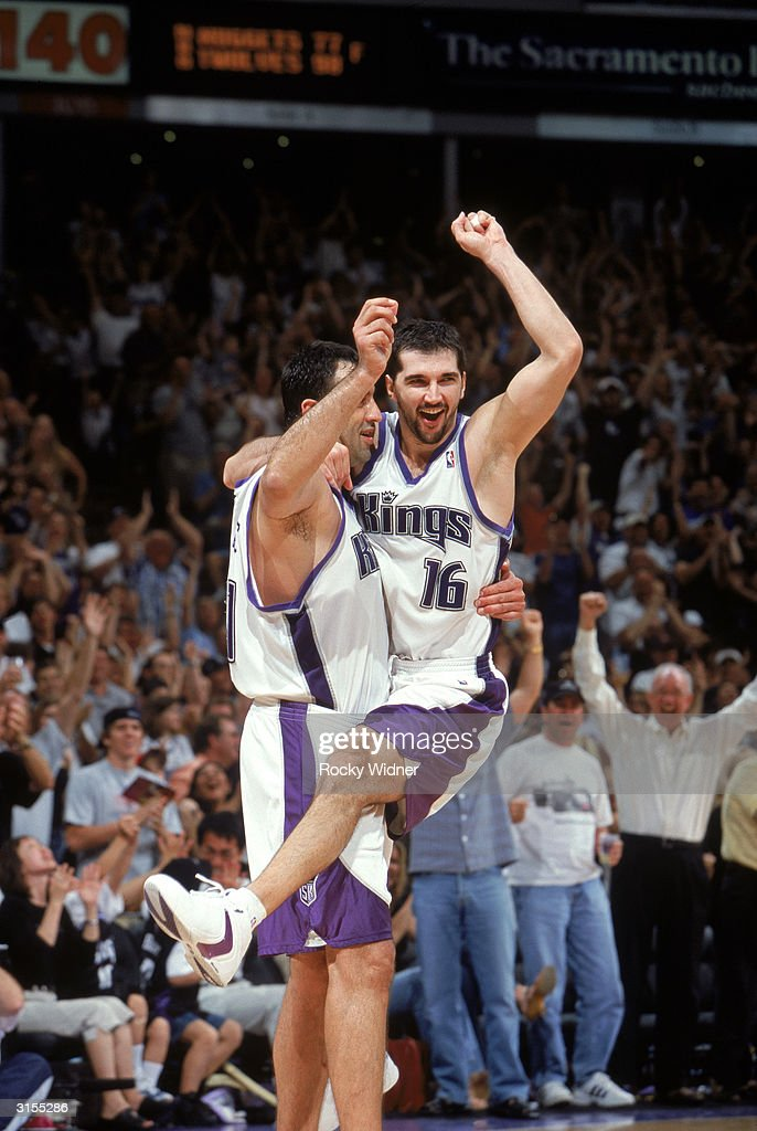 Predrag Stojakovic of the Sacramento Kings celebrates as he jumps into the arms of teammate Vlade Divac during the game against of the Houston...