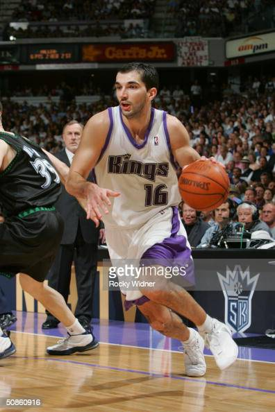 Predrag Stojakovic of the Sacramento Kings drives by Mark Madsen of the Minnesota Timberwolves in Game six of the Western Conference Semifinals...