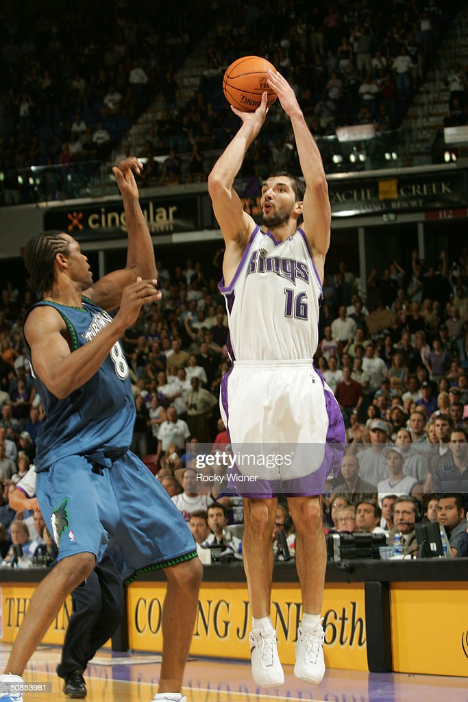 Predrag Stojakovic of the Sacramento Kings shoots the jump shot against Latrell Sprewell of the Minnesota Timberwolves in Game Three of the Western...
