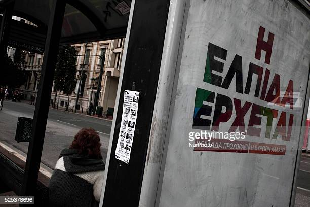 A preelection poster that reads quotHope is comingquot and a woman waiting at a bus station in Athens on January 18 2015