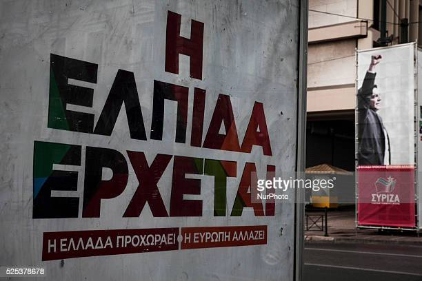 A preelection poster that reads quotHope is comingquot with a poster of Alexis Tsipras leader of SYRIZA on the background in Athens on January 18 2015