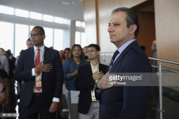 Preet Bharara stands for the US National Anthem at a naturalization ceremony in the observatory of One World Trade Center for new American citizens...