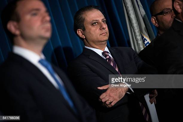 Preet Bharara United States Attorney for the Southern District of New York listens during a press conference announcing corruption charges against...