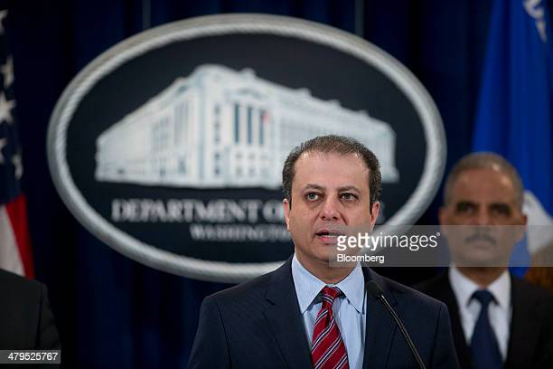 Preet Bharara US attorney for the Southern District of New York left speaks during a news conference with Eric Holder US attorney general at the...
