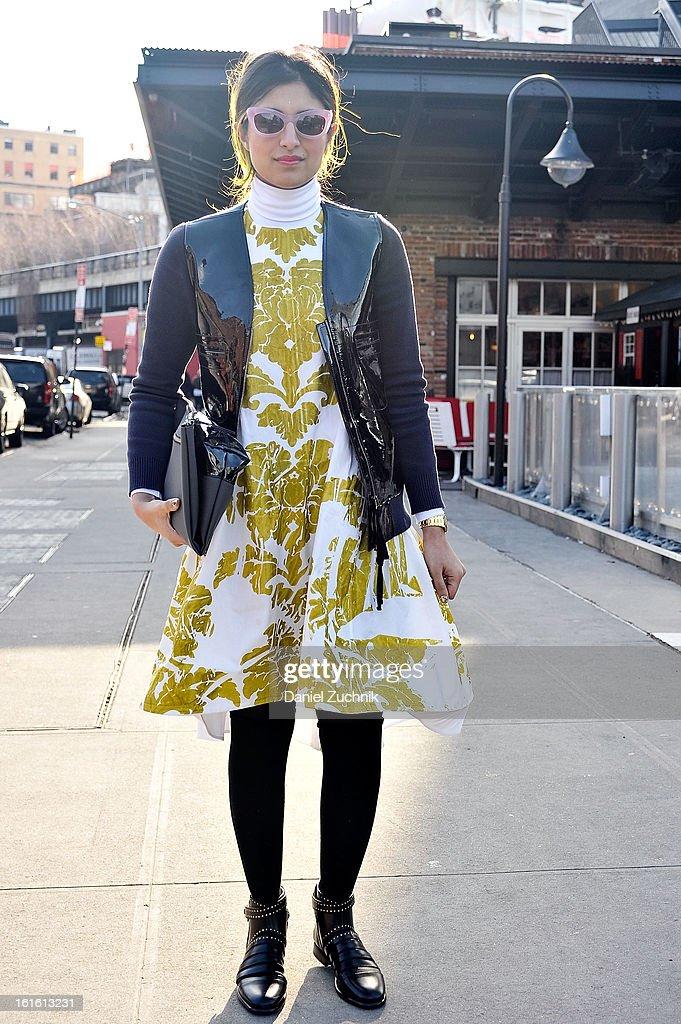 Preetma Singh, market editor for Wall Street Journal, seen outside the Nonoo show wearing a Joe Fresh dress on February 12, 2013 in New York City.