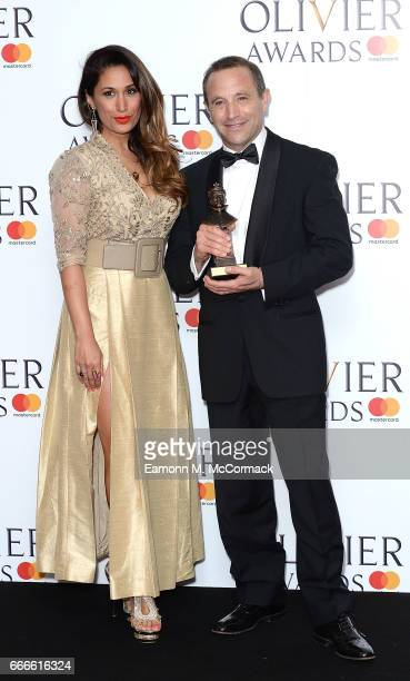 Preeya Kalidas with Mark Wigglesworth and his award for Outstanding Achievement in Opera for Don Giovanni and Lulu in the winners room at The Olivier...