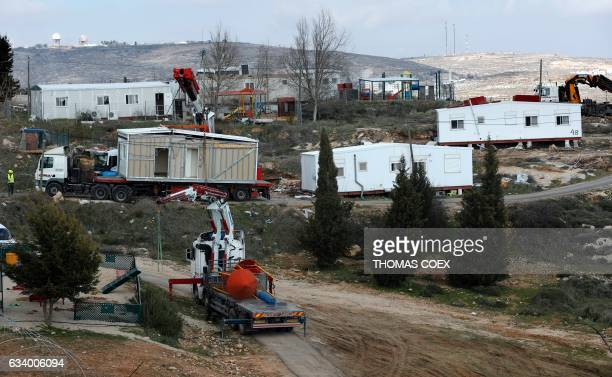 Prefabricated houses are removed from the Israeli Amona wildcat outpost northeast of Ramallah in the occupied West Bank on February 6 2017 Israeli...