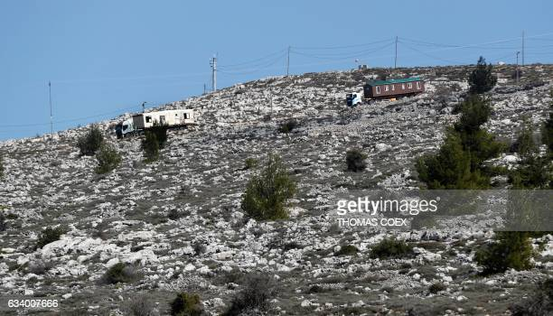 Prefabricated houses transported by lorries after being are removed from the Israeli Amona wildcat outpost northeast of Ramallah in the occupied West...