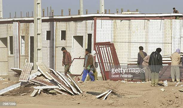 Prefabricated housing goes up on February 15 on the outskirts of Bam Iran as rebuilding begins after a devastating December 26 earthquake that...