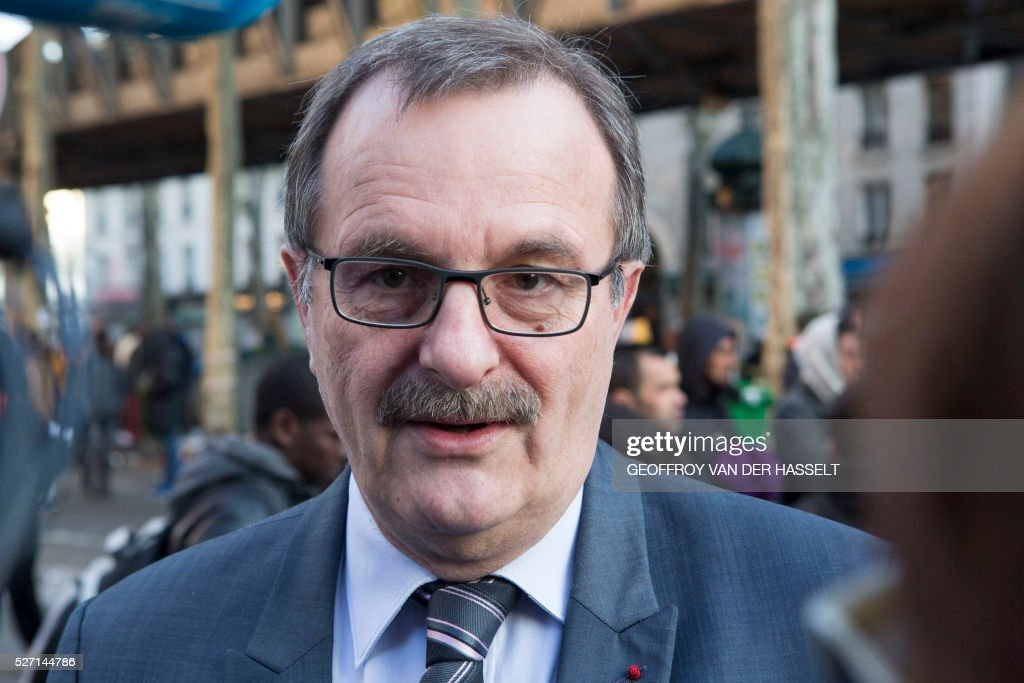 Prefect of Ile-de-France and Paris, Jean-Fran��ois Carenco talks to the press during the evacuation by the police of a makeshift camp under the Stalingrad metro station in Paris, on May 2, 2016. / AFP / Geoffroy Van der Hasselt