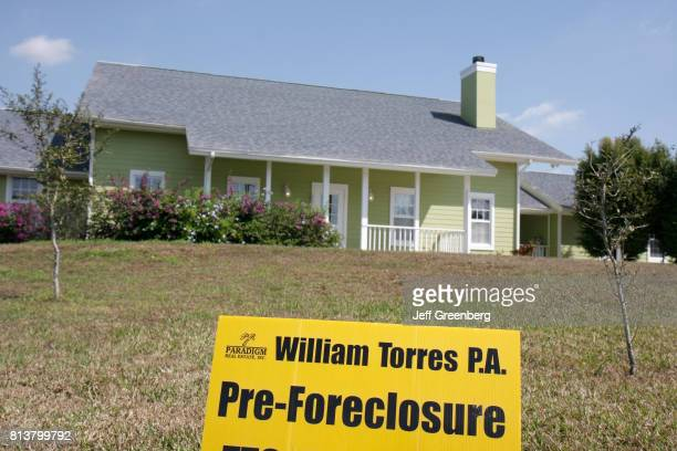 A preforeclosure sign in front of a house at Port Saint Lucie