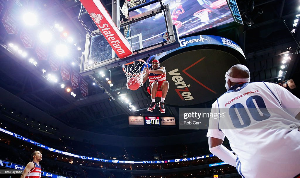 A preformer dunk the ball during a timeout of the Washington Wizards and Atlanta Hawks game at Verizon Center on December 18, 2012 in Washington, DC.