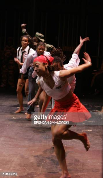 Preformers from the Ezibu Muntu Dance Company dance during a Kwanzaa celebration 26 December 2004 at the Lincoln Theater in Washington Celebrated...