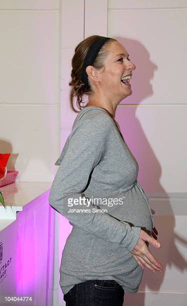 Pregnant actress Lisa Martinek laughs during a Bellybutton outlet store opening at Ingolstadt Village on September 13 2010 in Ingolstadt Germany