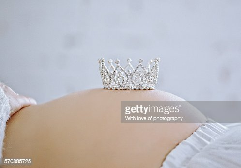 Pregnant belly with a crown for a baby princess