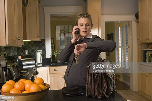 Pregnant businesswoman talking on phone
