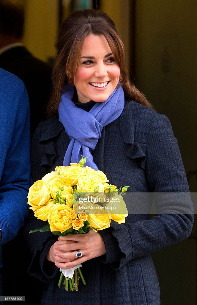 A pregnant <a gi-track='captionPersonalityLinkClicked' href=/galleries/search?phrase=Catherine+-+Duchess+of+Cambridge&family=editorial&specificpeople=542588 ng-click='$event.stopPropagation()'>Catherine</a>, Duchess of Cambridge accompanied by her husband Prince William, Duke of Cambridge leaves the King Edward VII hospital where she was being treated for acute morning sickness (Hyperemesis Gravidarum) on December 06, 2012 in London, England.