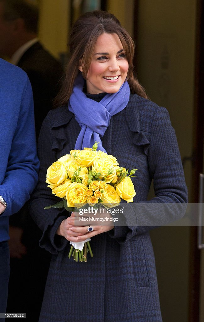 A pregnant Catherine, Duchess of Cambridge accompanied by her husband Prince William, Duke of Cambridge leaves the King Edward VII hospital where she was being treated for acute morning sickness (Hyperemesis Gravidarum) on December 06, 2012 in London, England.