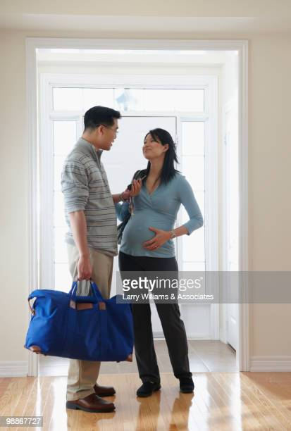 Pregnant Chinese woman and husband leaving for hospital