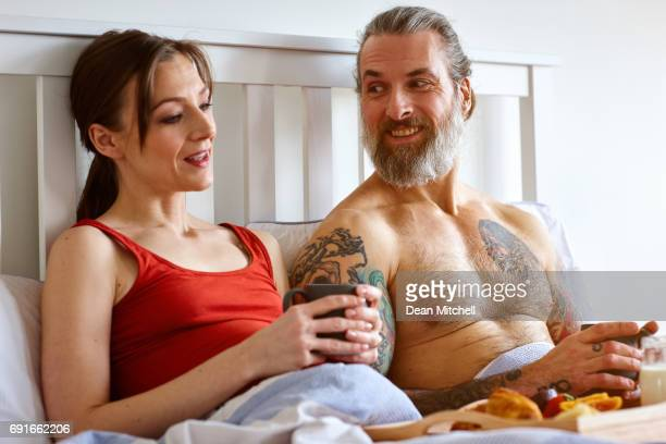 Pregnant couple having bed tea