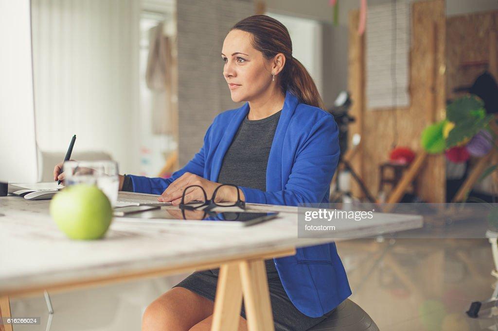 Pregnant graphic designer in studio : Stock Photo