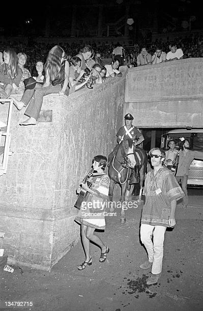 A pregnant Joan Baez arrives to sing at Harvard Stadium Brighton Boston Massachusetts 1969
