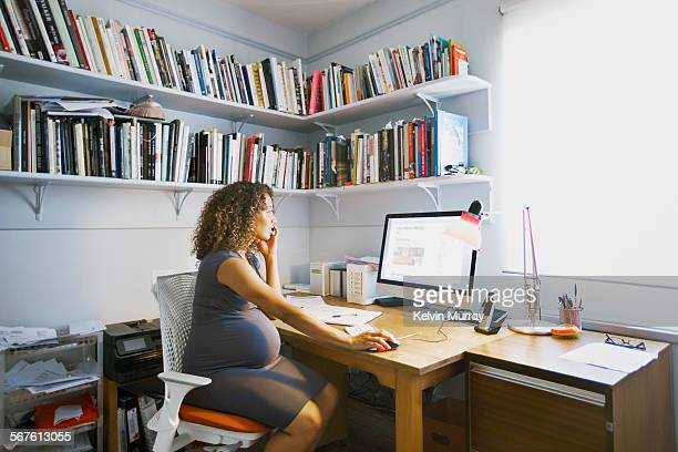 Pregnant lady works from her home office