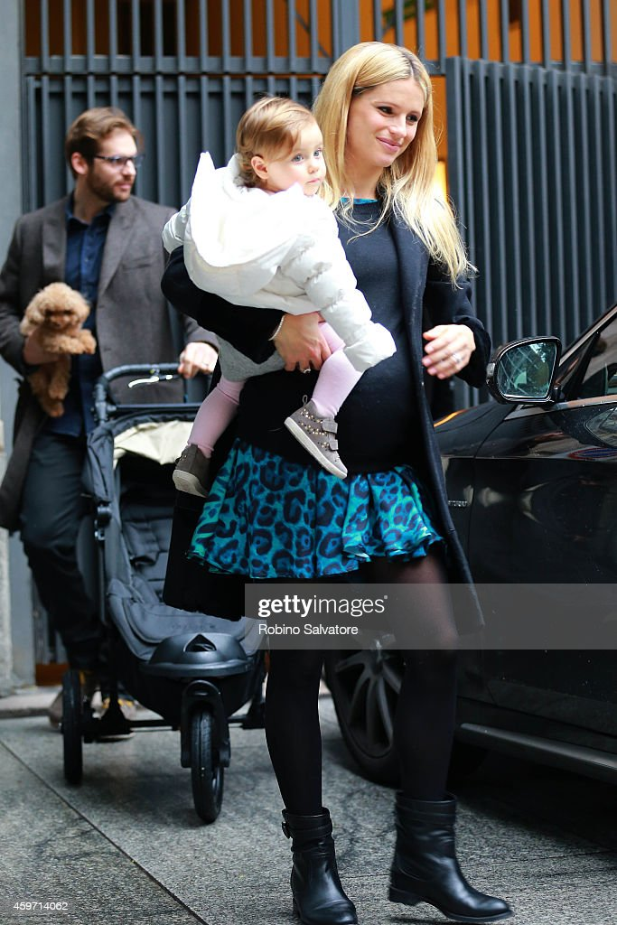 A pregnant Michelle Hunziker is seen with her husband Tomaso Trussardi and their daughter Sole Trussardi at the Tussardi Showroom on November 29 2014...