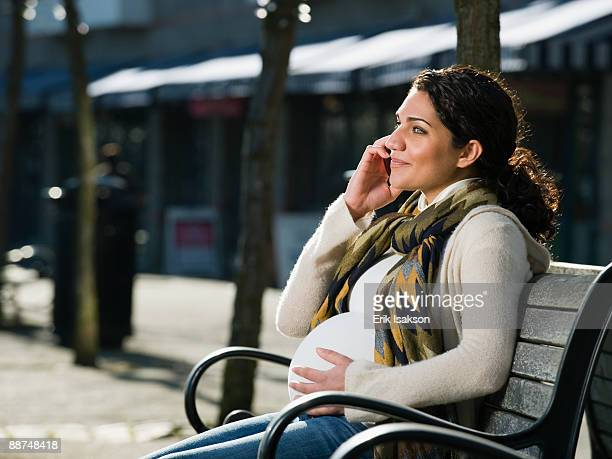 Pregnant Middle Eastern woman talking on cell phone