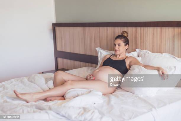 Pregnant millennial woman resting at home