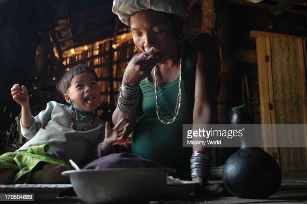 A pregnant Murong tribal woman eating food in her house Bandarban Bangladesh March 17 2007