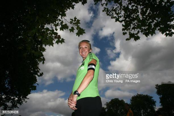 A pregnant Paula Radcliffe smiles after competing in the Nike Run London 10 km run at Hyde Park London
