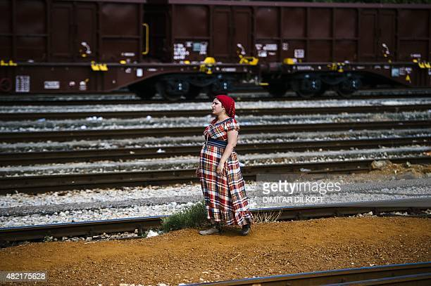 A pregnant Syrian migrant walks on train tracks towards the town of Gevgelija on July 27 on the MacedonianGreek border trying to catch a train to...