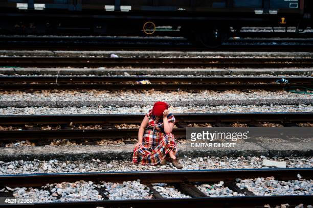 A pregnant Syrian woman takes a rest on train tracks towards the town of Gevgelija on July 27 on the MacedonianGreek border trying to catch a train...