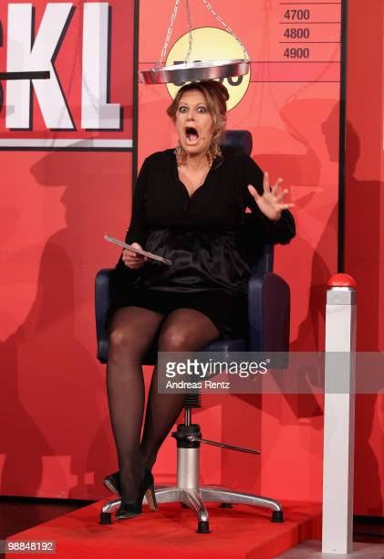 Pregnant TV host Barbara Schoeneberger reacts during the SKL show 'Tag des Gluecks' at Tempodrom on May 4 2010 in Berlin Germany