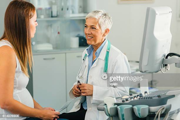 Pregnant Woman And Her Female Doctor In A Consultation.