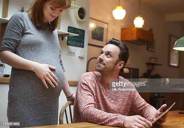 Pregnant woman and partner planning new life