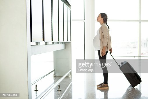 Pregnant woman at the airport