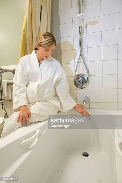 Pregnant woman by bathtub