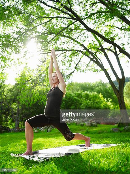 Pregnant woman doing yoga outdoors