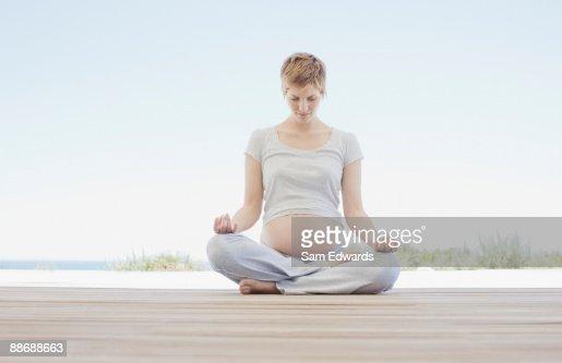 Pregnant woman doing yoga : Stock Photo