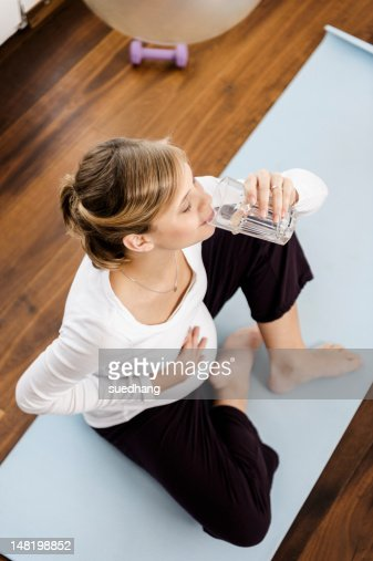 Pregnant woman drinking water : Stock Photo